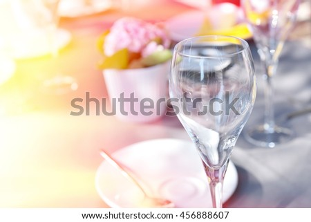 Details of wedding table with wine glasses sunlit