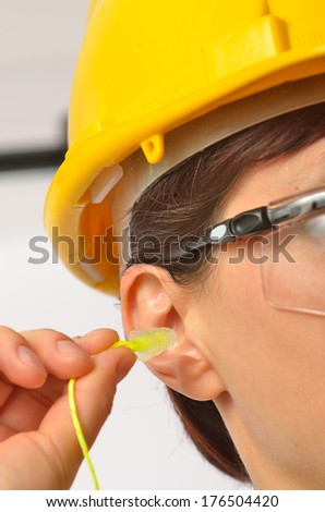Details of Woman with protective ear plugs - stock photo