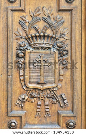 Details of woodcuts in the ancient and historic gates of Vieux L - stock photo