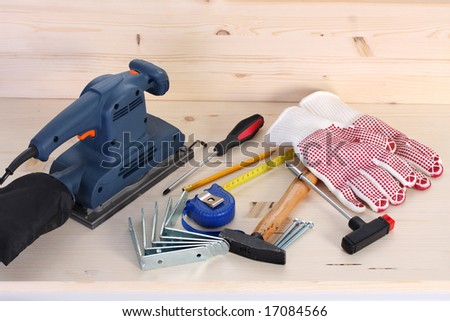 details of work tools on wooden plank - stock photo