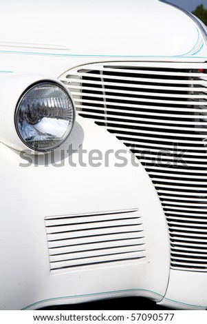 Details on a white Hot Rod Car