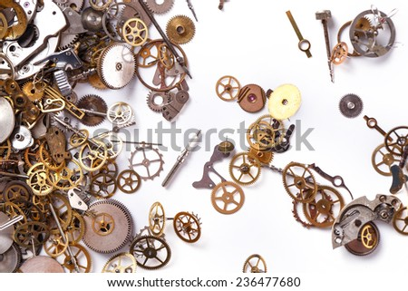 Details, technology. Heap of small gears on a white background - stock photo