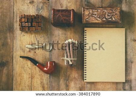detective concept. Private Detective tools: magnifier glass, old keys, smoking pipe, notebook. top view. vintage filtered image  - stock photo