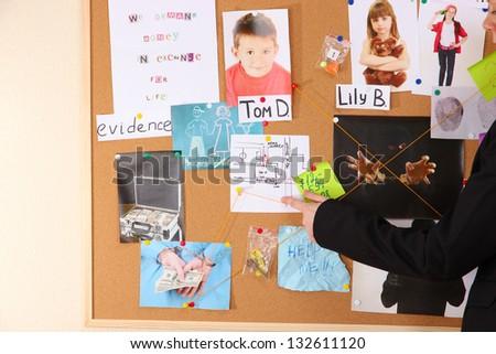 Detective investigating abduction of children - stock photo