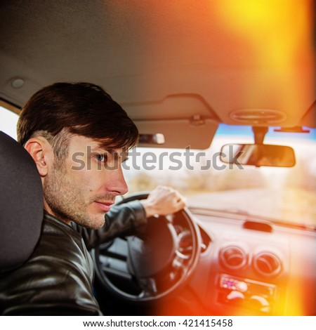 Detective man in the car watching