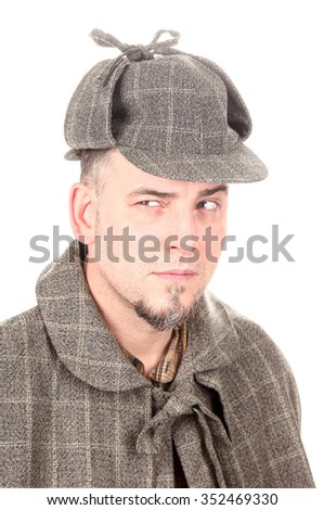 Detective Sherlock Holmes is thinking and solving problem - stock photo
