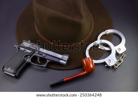 detective team, semiautomatic pistol handcuffs hat and pipe - stock photo