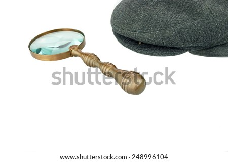 Detective Warm Cap and Vintage Magnifying Glass Isolated on White Background