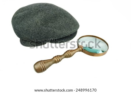 Detective Warm Cap and Vintage Magnifying Glass Isolated on White Background - stock photo
