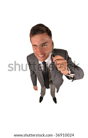Detective with magnifying glass in a hand isolated on a white background - stock photo