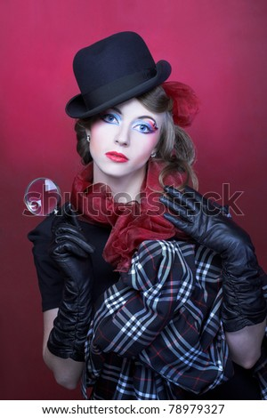 Detective. Young stylish lady in black hat and with loop.