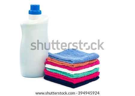 Detergent and stack towels isolated on white background.