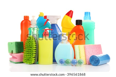 Detergent bottles and cleaning supplies isolated on white - stock photo