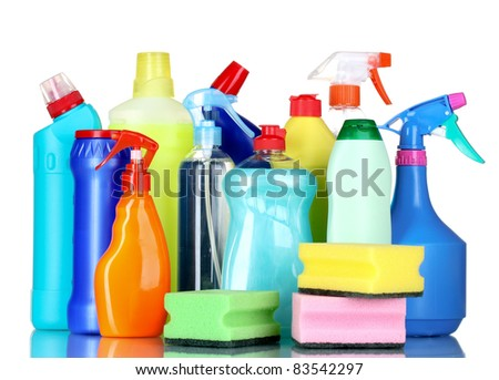 detergent bottles and sponges isolated on white