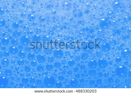 detergent foam bubble with blue tone for background