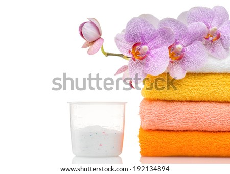 Detergent for washing machine in laundry with towels in the white background. - stock photo