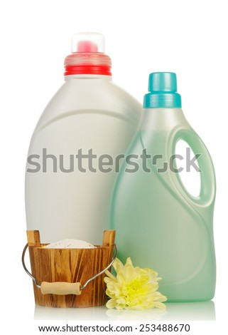 Detergent in bottles and flower isolated on white background - stock photo