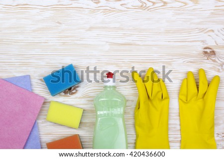 Detergent,sponges, rags and latex gloves - stock photo