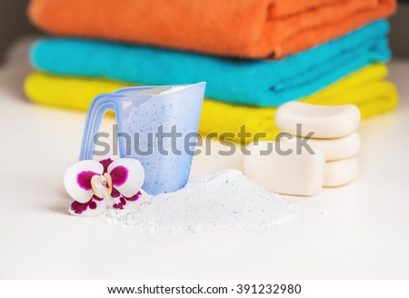 Detergent , towels and pieces of soap. Accessories for washing and cleaning - stock photo