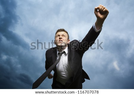 Determination to achieve the goal. A young man runs-shot from below. - stock photo