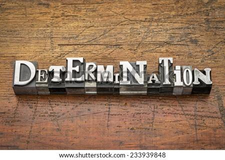 determination  word in mixed vintage metal type printing blocks over grunge wood - stock photo