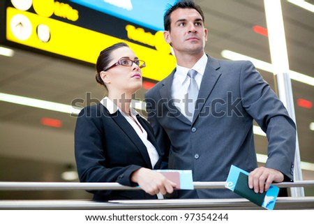 determined business travellers in airport - stock photo