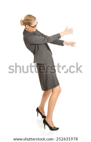 Determined businesswoman pulling a stick - stock photo