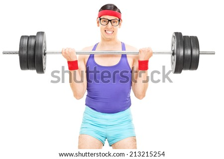 Determined guy lifting a heavy barbell isolated on white background - stock photo