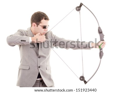 Determined handsome businessman aiming at target with bow - stock photo
