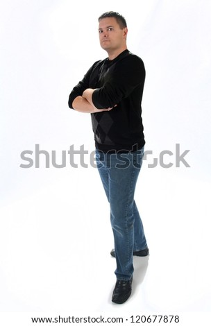 Determined man standing with arms crossed - stock photo