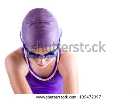 Determined young swimmer in dive pose