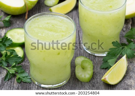 detox cocktail of green apple, celery and lime, horizontal, close-up - stock photo
