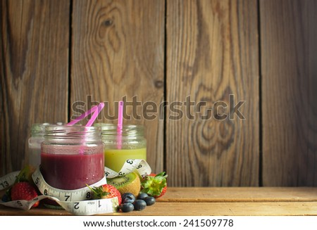 Detox smoothies in jars with space  - stock photo