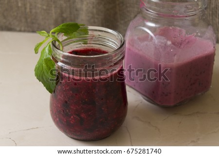 Detox water with berries in a glass jar. Improvement of the body. Summer time.