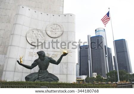 DETROIT-AUGUST10,2015: Spirit of Detroit Statue and Renaissance Center in downtown Detroit. August 10,2015, Detroit, Michigan - stock photo