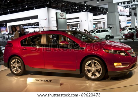 DETROIT - JANUARY 23:  A 2011 Chevrolet Volt on display at the North American International Auto Show on January 23, 2011 in Detroit, Michigan. - stock photo