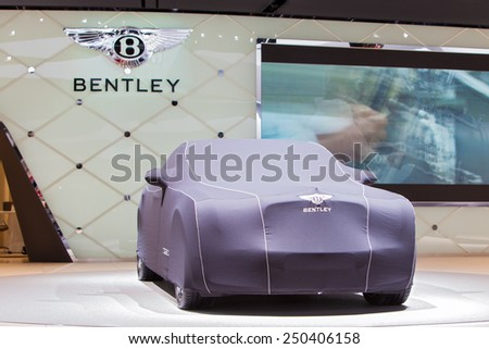 DETROIT - JANUARY 12: A covered Bentley on display January 12th, 2015 at the 2015 North American International Auto Show in Detroit, Michigan. - stock photo