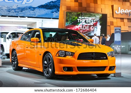 DETROIT - JANUARY 16 : A Dodge Charger SRT Super Bee on display at the North American International Auto Show media preview  January 16, 2014 in Detroit, Michigan. - stock photo