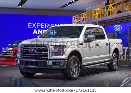 DETROIT - JANUARY 14 :A Ford F-150 XLT on display at the North American International Auto Show media preview  January 14, 2014 in Detroit, Michigan. - stock photo