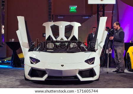 DETROIT - JANUARY 12 : A Lamborghini Aventador on display at The Gallery media preview in the MGM Grand Casino January 12, 2014 in Detroit, Michigan. - stock photo