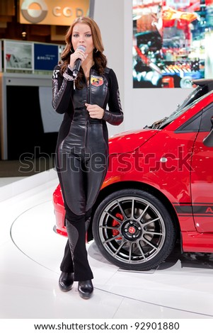DETROIT - JANUARY 11: A spokesmodel for the 2013 Fiat Abarth at the 2012 North American International Auto Show Industry Preview on January 11, 2012 in Detroit, Michigan.