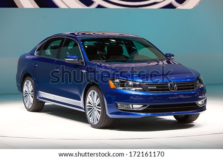 DETROIT - JANUARY 14 : A Volkswagen Passat with Blue Motion on display at the North American International Auto Show media preview  January 14, 2014 in Detroit, Michigan. - stock photo