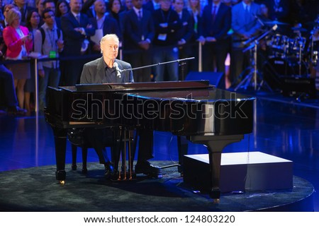 DETROIT - JANUARY 14 : Bruce Hornsby and the Noisemakers perform during the Mercedes event at The North American International Auto Show  January 14, 2013 in Detroit, Michigan. - stock photo