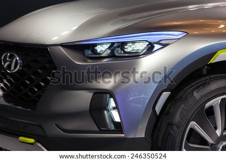 DETROIT - JANUARY 15: Detail of the headlight of the Hyundai Santa Cruz concept vehicle January 15th, 2015 at the 2015 North American International Auto Show in Detroit, Michigan. - stock photo