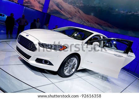 DETROIT - JANUARY 11: 2013 Ford Fusion Hybrid at the 2012 North American International Auto Show Industry Preview on January 11, 2012 in Detroit, Michigan. - stock photo