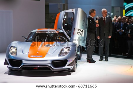 DETROIT - JANUARY 10: Porsche executives discuss the new 918 RSR at the North American International Auto Show Press Preview on January 10, 2011 in Detroit, Michigan.
