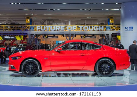DETROIT - JANUARY 14 : Profile of the new 2015 Ford Mustang at the North American International Auto Show media preview  January 14, 2014 in Detroit, Michigan. - stock photo