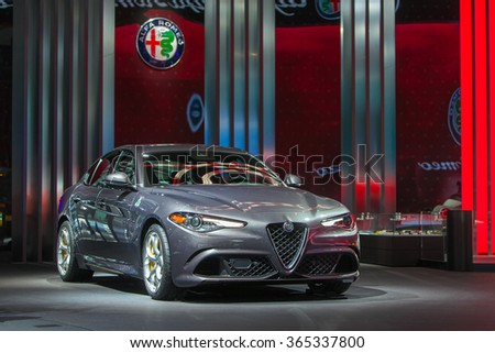 DETROIT - JANUARY 12: The 2016 Alfa Romeo Giulia on display at the North American International Auto Show media preview January 12, 2016 in Detroit, Michigan. - stock photo