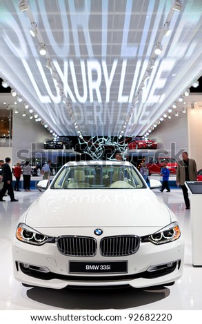 DETROIT - JANUARY 11: The 2012 BMW 335i on display at the 2012 North American International Auto Show Industry Preview on January 11, 2012 in Detroit, Michigan. - stock photo