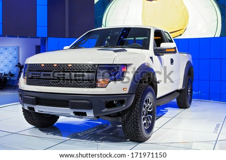 DETROIT - JANUARY 13 : The 2014 Ford SVT Raptor Pickup Truck on display at the North American International Auto Show media preview  January 13, 2014 in Detroit, Michigan. - stock photo